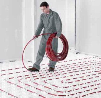 Pose de tubes de plancher chauffant